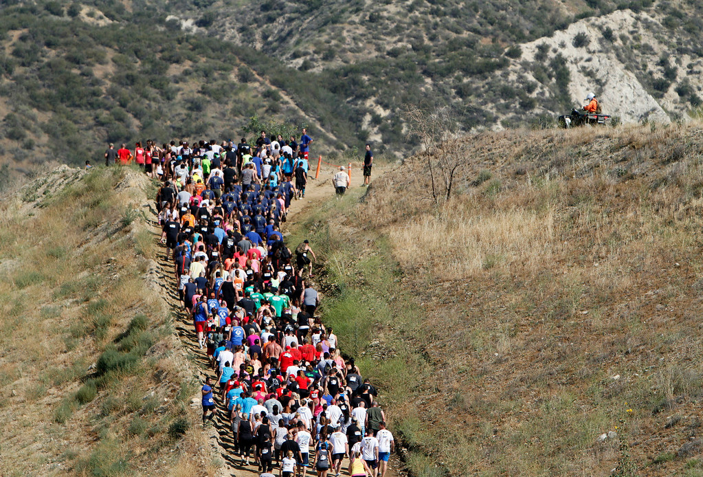 . Runners make their way up a hill during the Sheriff�s Athletic Federation\'s annual 5K Mud Run on Saturday, May 17, 2014 at the Sheriff�s Department Academy in Devore, Ca. (Photo by Micah Escamilla/San Bernardino Sun)