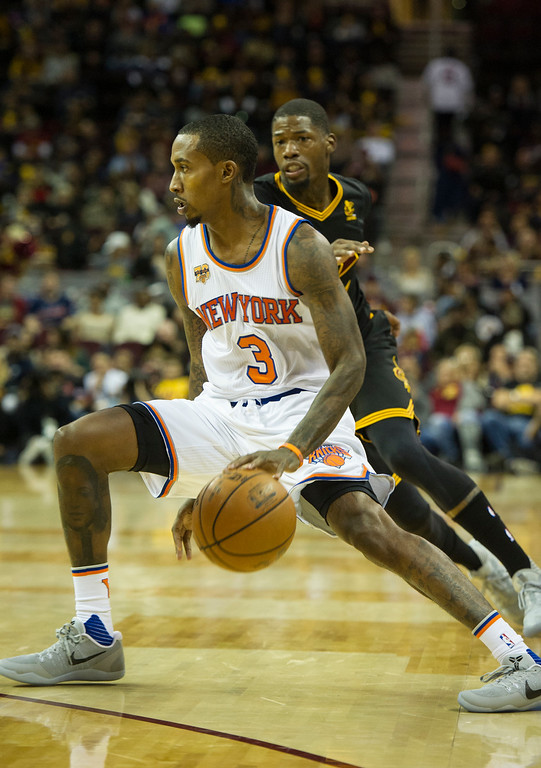 . New York Knicks\' Brandon Jennings (3) drives past Cleveland Cavaliers\' DeAndre Liggins (14) during the second half of a basketball game in Cleveland, Tuesday, Oct. 25, 2016. Cleveland won 117-88. (AP Photo/Phil Long)