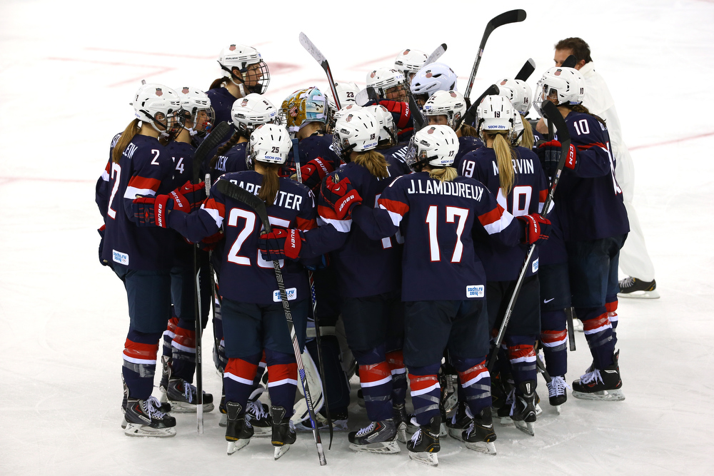 . SOCHI, RUSSIA - FEBRUARY 17:  The United States celebrate after defeating Sweden 6-1 during the Women\'s Ice Hockey Playoffs Semifinal game on day ten of the Sochi 2014 Winter Olympics at Shayba Arena on February 17, 2014 in Sochi, Russia.  (Photo by Doug Pensinger/Getty Images)