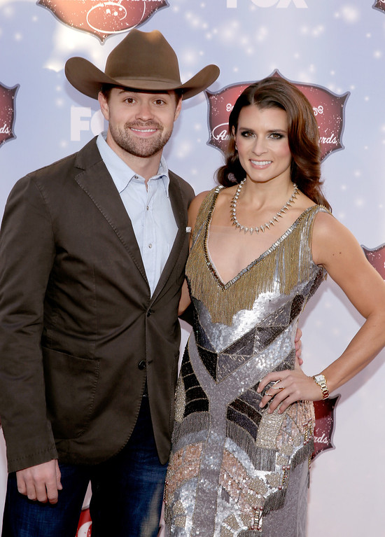 . NASCAR Driver Ricky Stenhouse, Jr. (L) and co-host Danica Patrick arrive at the 2013 American Country Awards at the Mandalay Bay Events Center on December 10, 2013 in Las Vegas, Nevada.  (Photo by Isaac Brekken/Getty Images)