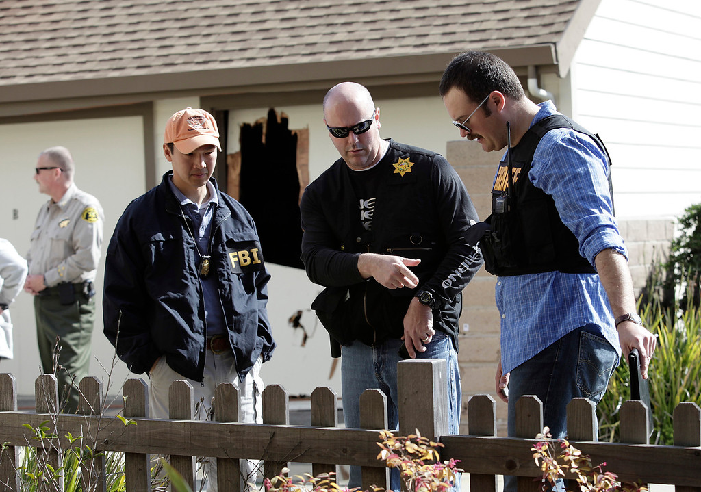 """. Members of the FBI and local police investigators at the scene of a shoot out between suspect Jermy Peter Goulet and Santa Cruz police on Doyle St. in Santa Cruz, Calif. on Wednesday, Feb. 27, 2013.  Santa Cruz police officers, detective Sgt. Loran \""""Butch\"""" Baker and detective Elizabeth Butler were believed to be gunned down by Goulet yesterday while investigating a possible domestic violence or sexual assault when the suspect fired at them. Goulet was later gunned down and killed in this area when he exchanged gunfire with police during a manhunt. (Gary Reyes/ Staff)"""