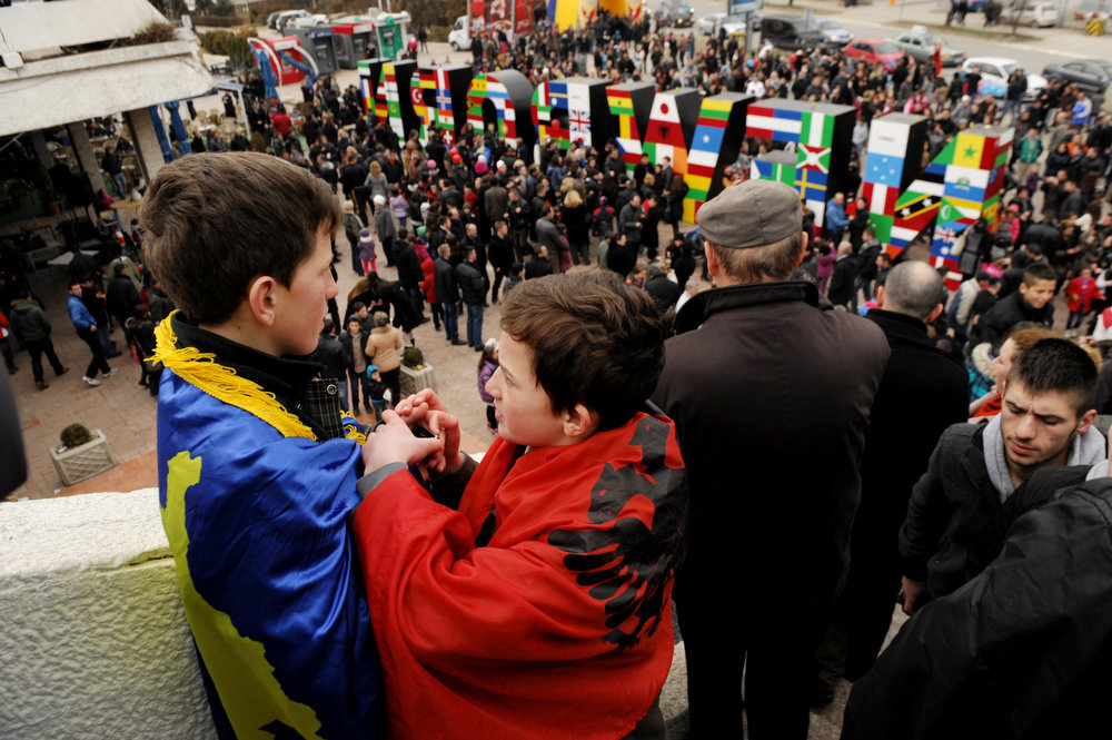 Description of . Boys wearing the Kosovan flag (L) and the Albanian flag (2nd L) attend celebrations of the fifth anniversary of Kosovo's declaration of independence in Pristina on February 17, 2013. Kosovo is marking the fifth anniversary of its unilateral declaration of independence from Serbia. An ethnic Albanian-majority province of Serbia, Kosovo proclaimed independence unilaterally on February 17, 2008 in a Western-backed move seen as the final chapter in the bloody breakup of Yugoslavia. ARMEND NIMANI/AFP/Getty Images