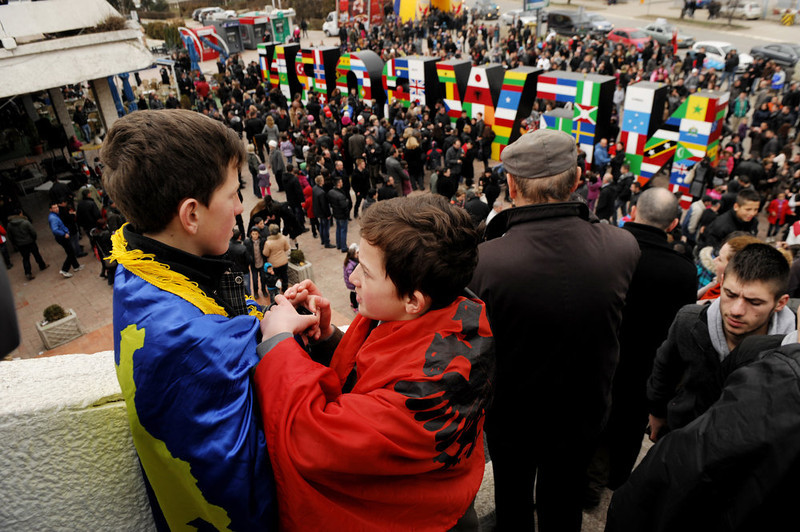 . Boys wearing the Kosovan flag (L) and the Albanian flag (2nd L) attend celebrations of the fifth anniversary of Kosovo\'s declaration of independence in Pristina on February 17, 2013. Kosovo is marking the fifth anniversary of its unilateral declaration of independence from Serbia. An ethnic Albanian-majority province of Serbia, Kosovo proclaimed independence unilaterally on February 17, 2008 in a Western-backed move seen as the final chapter in the bloody breakup of Yugoslavia. ARMEND NIMANI/AFP/Getty Images