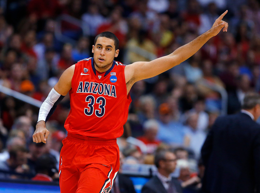. Arizona\'s Grant Jerrett celebrates following a basket against Ohio State during the first half of a West Regional semifinal in the NCAA men\'s college basketball tournament, Thursday, March 28, 2013, in Los Angeles. (AP Photo/Jae C. Hong)