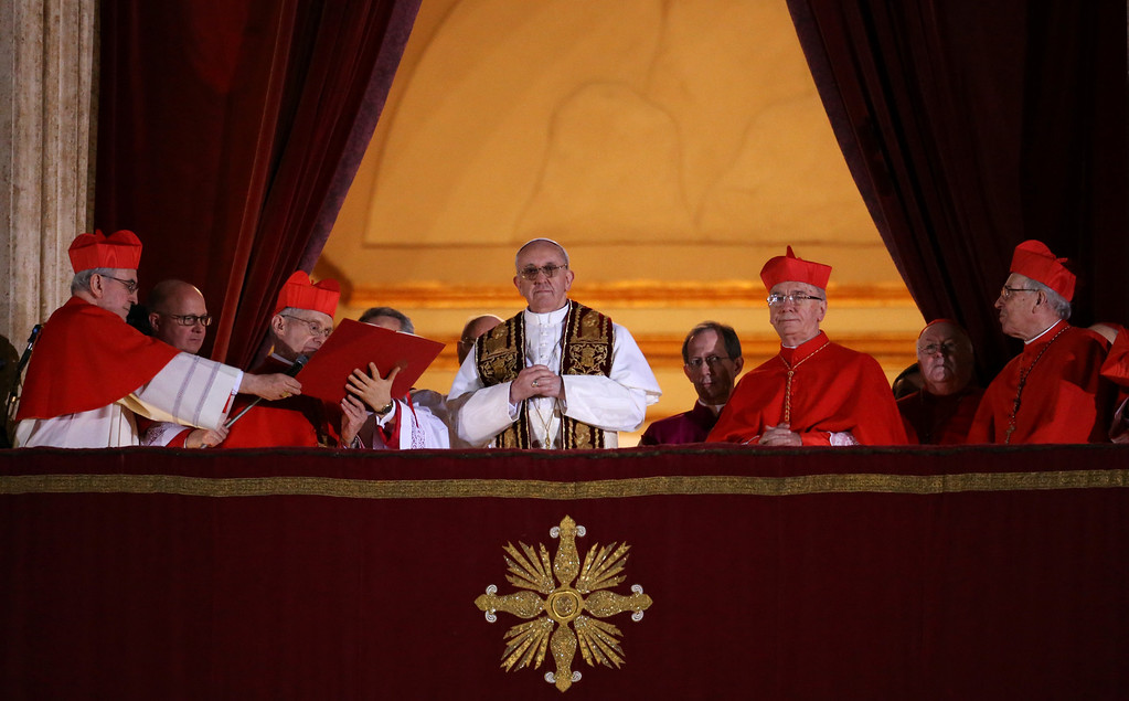 . Newly elected Pope Francis I appears on the central balcony of St Peter\'s Basilica on March 13, 2013 in Vatican City, Vatican. Argentinian Cardinal Jorge Mario Bergoglio was elected as the 266th Pontiff and will lead the world\'s 1.2 billion Catholics.  (Photo by Peter Macdiarmid/Getty Images)