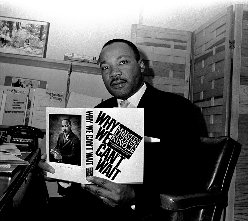 ". Dr. Martin Luther King, Jr. displays his book ""Why We Can\'t Wait\"",  to be used during his poor people\'s campaign this spring and summer.  King, head of the Southern Christian Leadership Conference, showed off the book in Atlanta, March 4, 1968.  (AP Photo/Horace Cort)"