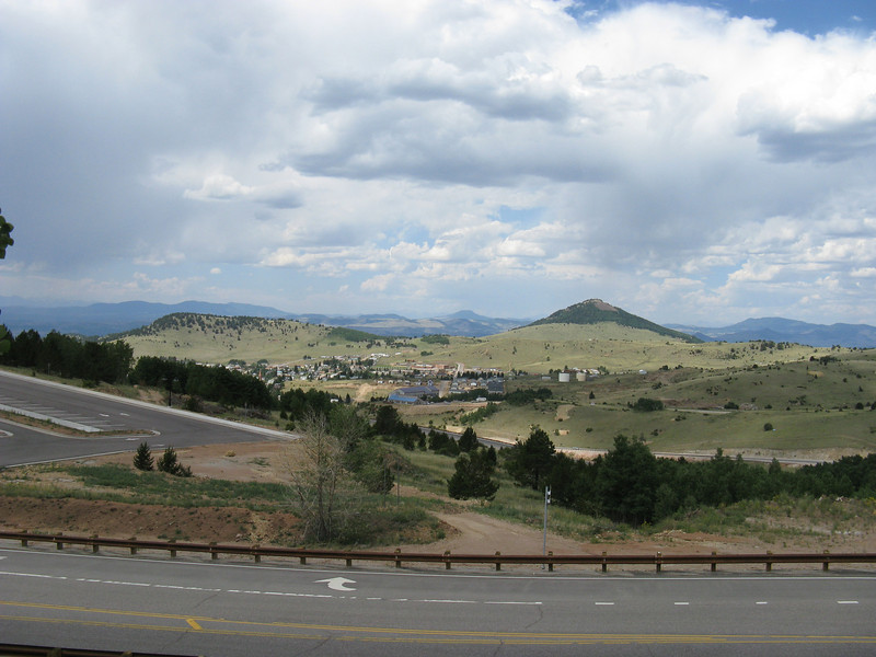 Back outside the mine, our pockets stuffed with high-grade ore, and looking down at Cripple Creek.