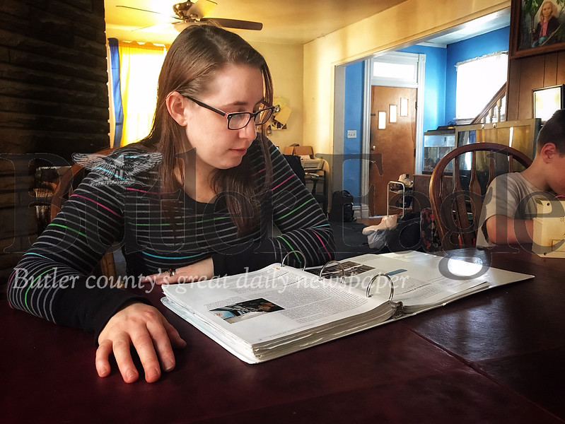 "Butler County Community College student Vanessa Eberle, 35, studies inside her home for her Abnormal Psychology course. Eberle was the state winner of the ""Finish What I Started"" scholarship from the Phi Theta Kappa's Middle States Region, an international academic organization."