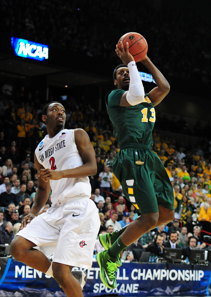 . Carlin Dupree #13 of the North Dakota State Bison shoots over Xavier Thames #2 of the San Diego State Aztecs in the first half during the Third Round of the 2014 NCAA Basketball Tournament at Spokane Veterans Memorial Arena on March 22, 2014 in Spokane, Washington.  (Photo by Steve Dykes/Getty Images)