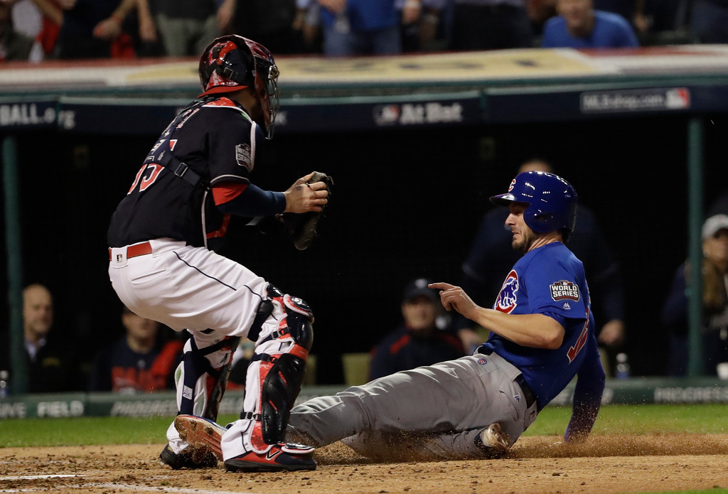 . CORRECTS CUBS PLAYER TO KRIS BRYANT, INSTEAD OF BEN ZOBRIST - Chicago Cubs\' Kris Bryant is safe at home as Cleveland Indians catcher Roberto Perez puts on a late tag during the fourth inning of Game 7 of the Major League Baseball World Series on Wednesday, Nov. 2, 2016, in Cleveland. (AP Photo/David J. Phillip)