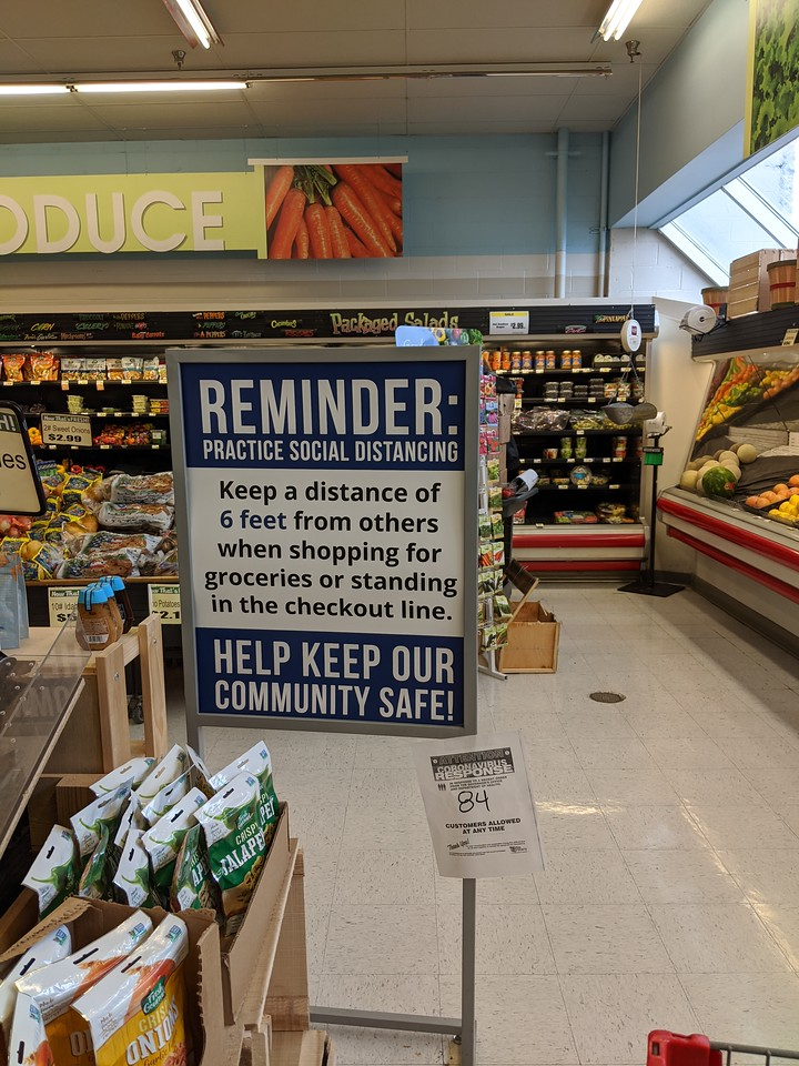 Social distancing reminder sign at IGA, Apr 26