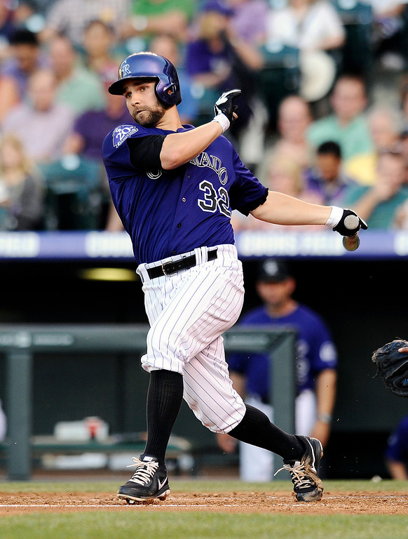 . Colorado Rockies Tyler Chatwood hits a two-run RBI-double in the second inning of a baseball game against the Milwaukee Brewers, Friday, July 26, 2013, in Denver. (AP Photo/Chris Schneider)