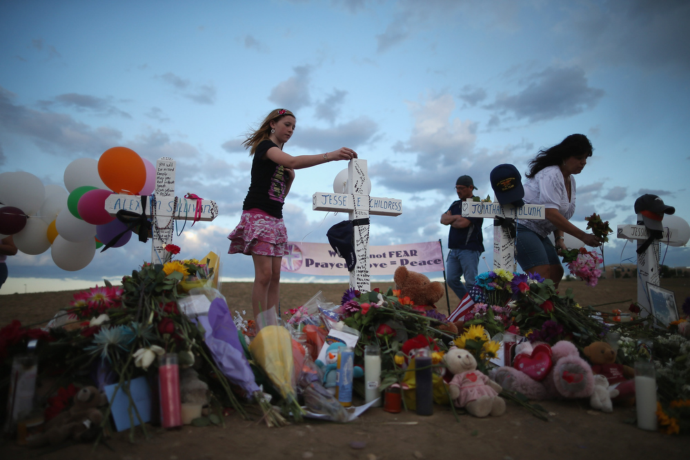 . Thousands of people continue to visit the makeshift memorial to the 12 movie theater shooting victims built across the street from the Century 16 Theater July 23, 2012 in Aurora, Colorado. Twenty-four-year-old James Holmes is suspected of killing 12 and injuring 58 others Friday during a shooting rampage at a screening of \'The Dark Knight Rises.\'  (Photo by Chip Somodevilla/Getty Images)
