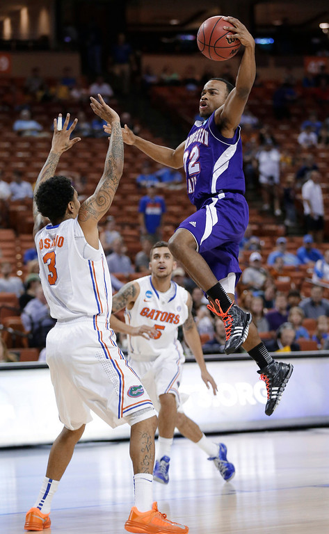 . Northwestern State\'s Brison White, right, drives to the basket over Florida\'s Mike Rosario (3) during the first half of a second-round game of the NCAA men\'s college basketball tournament Friday, March 22, 2013, in Austin, Texas.  (AP Photo/Eric Gay)