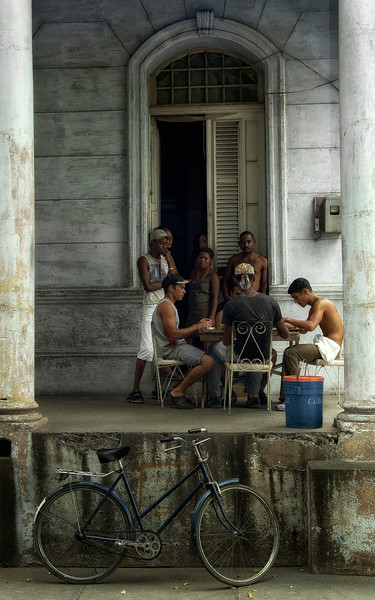 A game of dominoes is always close at hand in Cuba. In a country where TV and Internet is still for the privileged few, the game brings people together.   Small town in Central Cuba. 2006