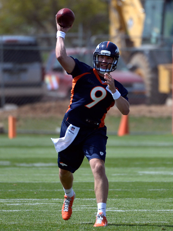 . QB Bryn Renner (9) runs through drills with fellow rookies as the Denver Broncos host their rookie minicamp at Dove Valley in Englewood on Friday, May 16, 2014.  (Kathryn Scott Osler, The Denver Post)