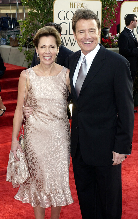 """. Bryan Cranston, nominated for best performance by an actor in a supporting role in a series, mini-series or motion picture made for television for his work in \""""Malcolm in the Middle,\"""" arrives with his wife Robin Dearden for the 60th Annual Golden Globe Awards, in Beverly Hills, Calif., Sunday, Jan. 19, 2003. (AP Photo/Mark J. Terrrill)"""