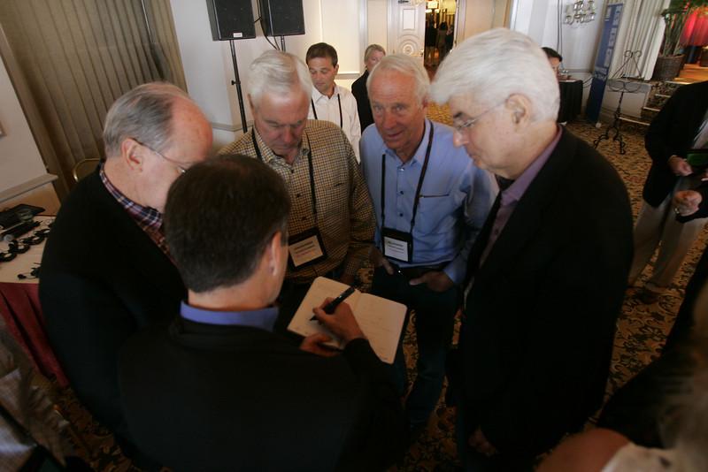"Jim Marggraff (front) demonstrates the Livescribe ""pen"" to (L-R) Bill Harris, Don Budinger, Bill Budinger, and Randy Blotky"