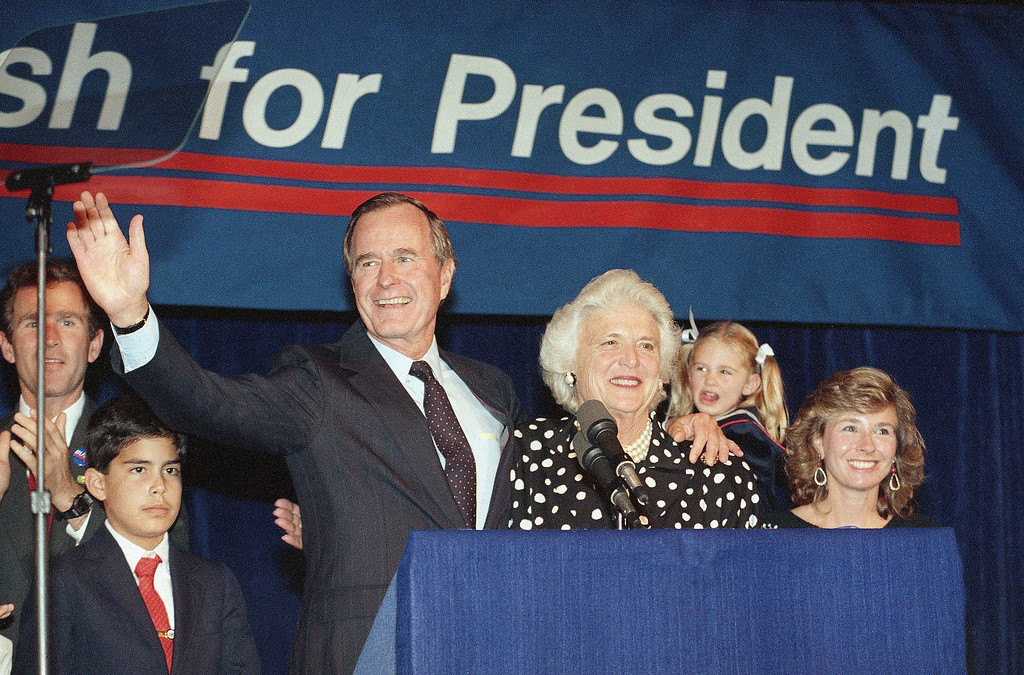 . Vice President George Bush and wife, Barbara, wave to supporters that turned out in Houston, Texas, to hear him announce he was a candidate for the Republican nomination for president of the United States, Oct. 12, 1987.  (AP Photo/Ed Kolenovsky)