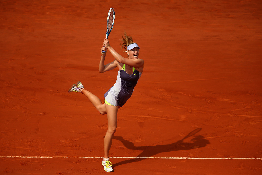 . Maria Sharapova of Russia plays a backhand in her Women\'s Singles Final match against Serena Williams of United States of America during day fourteen of French Open at Roland Garros on June 8, 2013 in Paris, France.  (Photo by Julian Finney/Getty Images)