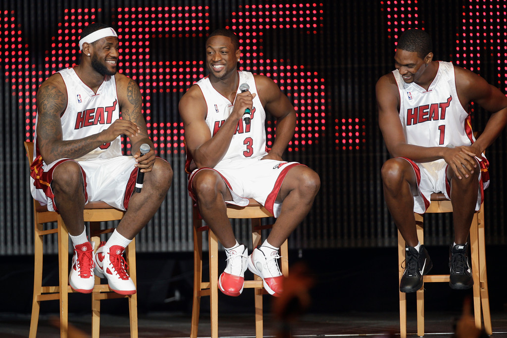 . LeBron James, (6), Dwyane Wade, (3), and Chris Bosh (1) appear at Fan Fest Friday, July 9, 2010 in Miami.  (AP Photo/J Pat Carter)