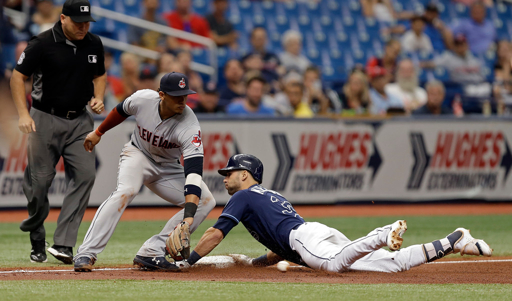 . Tampa Bay Rays\' Kevin Kiermaier slides into their base with a triple ahead of the throw to Cleveland Indians\' Erik Gonzalez during the sixth inning of a baseball game Wednesday, Sept. 12, 2018, in St. Petersburg, Fla. (AP Photo/Chris O\'Meara)