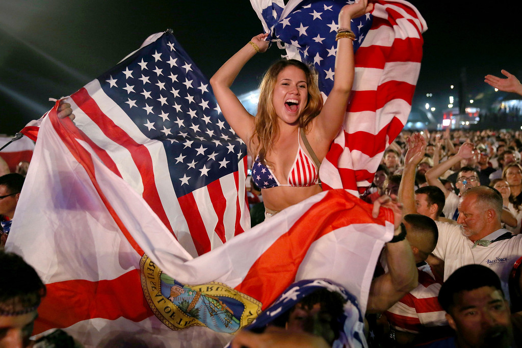 . American soccer fans react to their team beating Ghana 2-1 as they watch on a large screen at the FIFA World Cup Fan Fest on Copacabana beach on June 16, 2014 in Rio de Janeiro, Brazil. The teams are playing on the fifth day of the World Cup tournament.  (Photo by Joe Raedle/Getty Images)