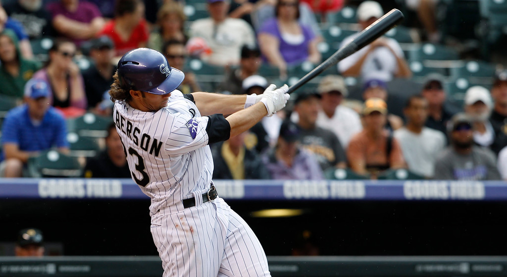 . Colorado Rockies\' Chrlie Culberson doubles against the Pittsburgh Pirates in the fourth inning a baseball game in Denver on Sunday, Aug. 11, 2013. (AP Photo/David Zalubowski)
