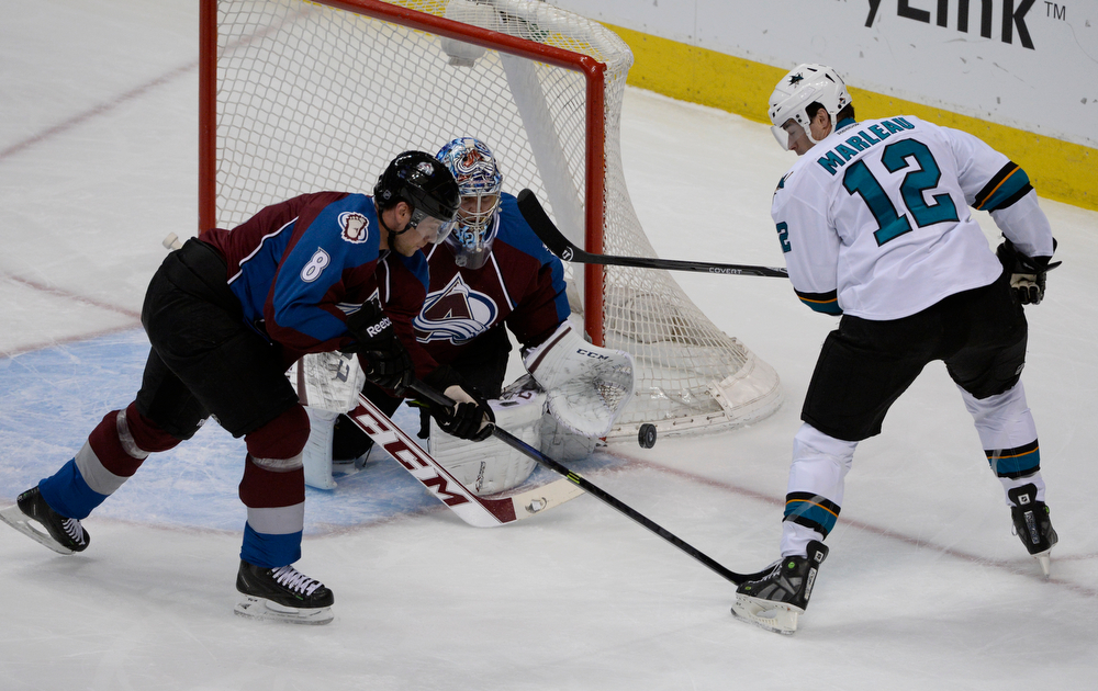 . Colorado Avalanche defenseman, Jan Hejda, left, defends the goal along with goalie Semyon Varlamov, against an attack by Patrick Marleau, San Jose Sharks, right, play at the Pepsi Center Saturday afternoon, March 29, 2014. (Photo By Andy Cross / The Denver Post)