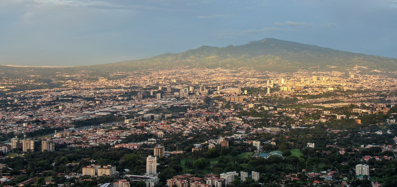 Aerial View of Downtown San Jose, Costa Rica including Escazu, La Sabana, National Stadium, and Irazu Volcano at Sunset