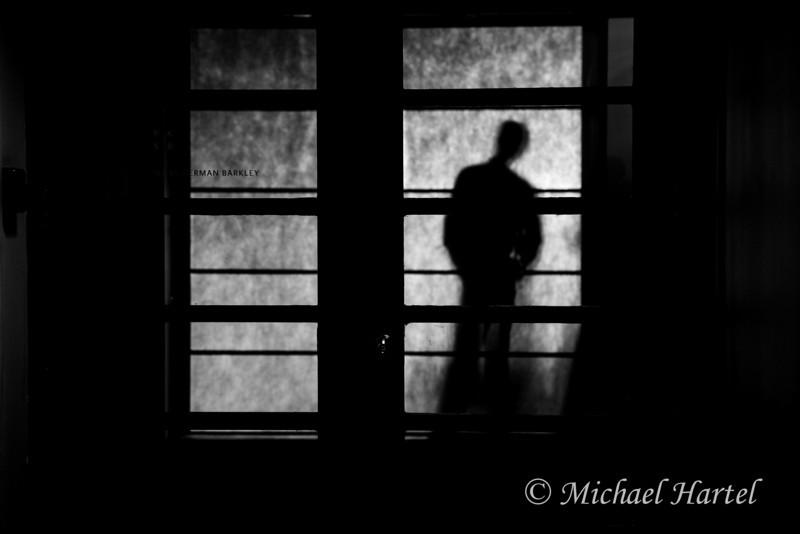 man behind paper screen 2.jpg
