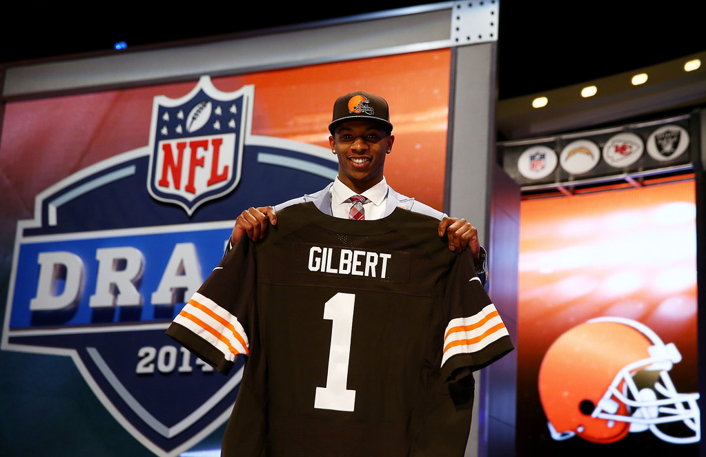 . Justin Gilbert of the Oklahoma State Cowboys poses with a jersey after he was picked #8 overall by the Cleveland Browns during the first round of the 2014 NFL Draft at Radio City Music Hall on May 8, 2014 in New York City.  (Photo by Elsa/Getty Images)