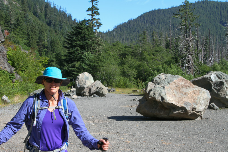 Mary and the boulders that came tumbling down the mountain this spring.
