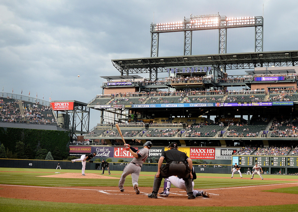 . Atlanta batter Andrelton Simmons jacked a grand-slam home run out of the park in the first inning off Colorado starter Juan Nicasio. The Colorado Rockies hosted the Atlanta Braves Tuesday night, June 10, 2014. (Photo by Karl Gehring/The Denver Post)