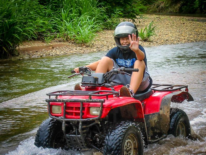 349 Justin crossing river Quad.jpg