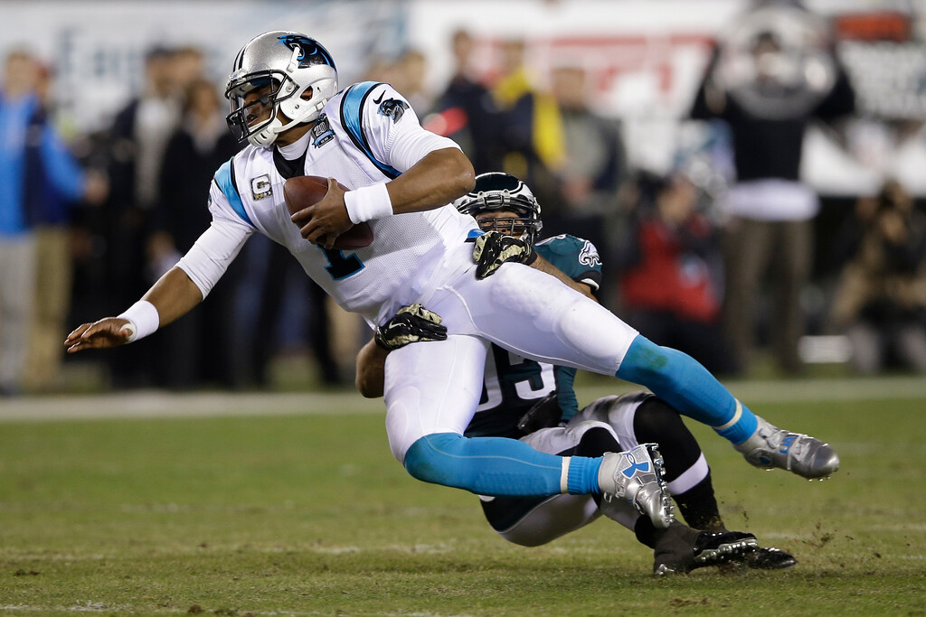 . Carolina Panthers\' Cam Newton (1) is tackled by Philadelphia Eagles\' Mychal Kendricks (95) during the first half of an NFL football game, Monday, Nov. 10, 2014, in Philadelphia. (AP Photo/Michael Perez)