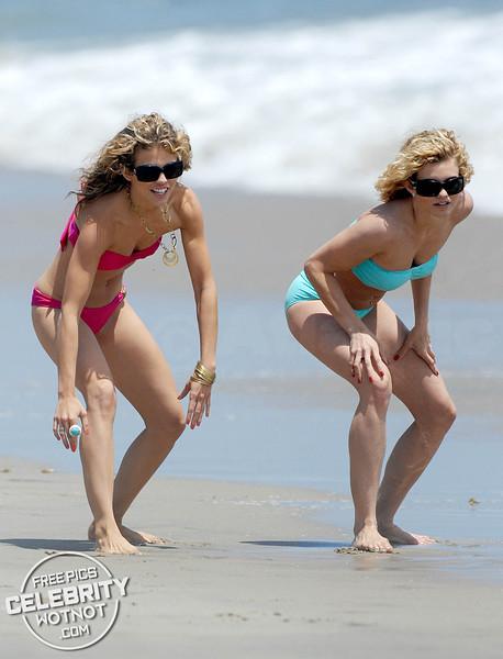 AnnaLynne McCord Races Her Sisters In A Pink Bikini!