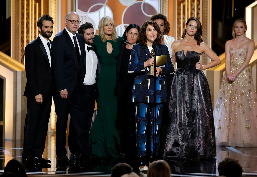 ". In this image released by NBC, Jill Soloway, foreground, accepts the award for best TV series, comedy or musical for ""Transparent\"" at the 72nd Annual Golden Globe Awards on Sunday, Jan. 11, 2015 at the Beverly Hilton Hotel in Beverly Hills, Calif. (AP Photo/NBC, Paul Drinkwater)"