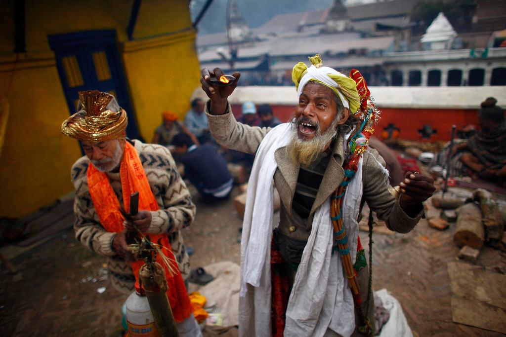 ". Hindu holy men sing religious songs during the \""Shivaratri\"" festival at the courtyard of the Pashupatinath Hindu temple in Katmandu, Nepal, Thursday, Feb. 27, 2014.  (AP Photo/Niranjan Shrestha)"