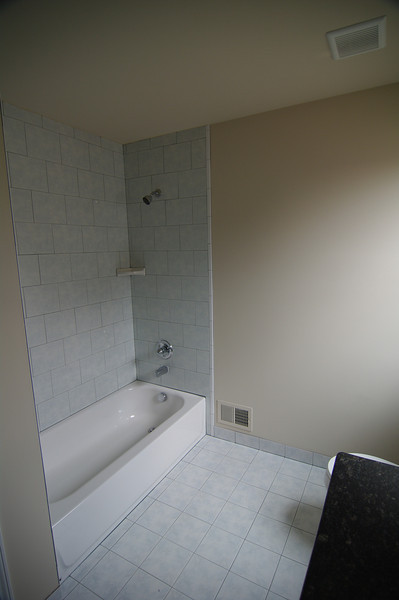 Bathroom upstairs.  I don't like the tile so much.  ** NO WE ARE NOT CHANGING IT $$$**
