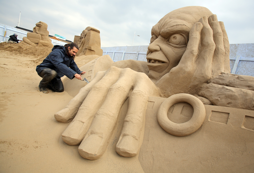 Description of . Sand sculptor Radavan Zivny works on a sand sculpture of Gollum as pieces are prepared as part of this year's Hollywood themed annual Weston-super-Mare Sand Sculpture festival on March 26, 2013 in Weston-Super-Mare, England. Due to open on Good Friday, currently twenty award winning sand sculptors from across the globe are working to create sand sculptures including Harry Potter, Marilyn Monroe and characters from the Star Wars films as part of the town's very own movie themed festival on the beach.  (Photo by Matt Cardy/Getty Images)