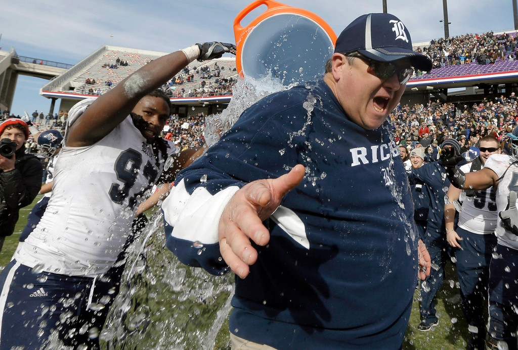 . Rice head coach Troy Calhoun is drenched in water by defensive end Jared Williams (97) after the end of the Armed Forces Bowl NCAA college football game against Air Force, Saturday, Dec. 29, 2012, in Fort Worth, Texas. Rice won 33-14. (AP Photo/LM Otero)