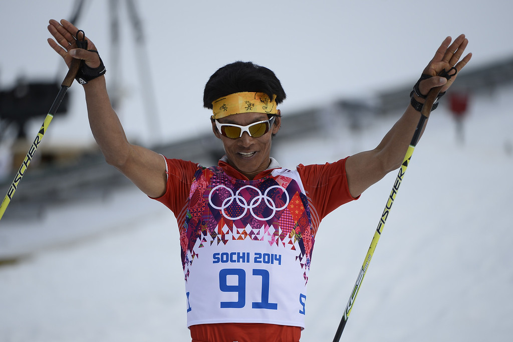 . Nepal\'s Dachhiri Sherpa celebrates coming in penultimate at the finish line of the Men\'s Cross-Country Skiing 15km Classic at the Laura Cross-Country Ski and Biathlon Center during the Sochi Winter Olympics on February 14, 2014 in Rosa Khutor near Sochi.  AFP PHOTO / PIERRE-PHILIPPE MARCOU/AFP/Getty Images