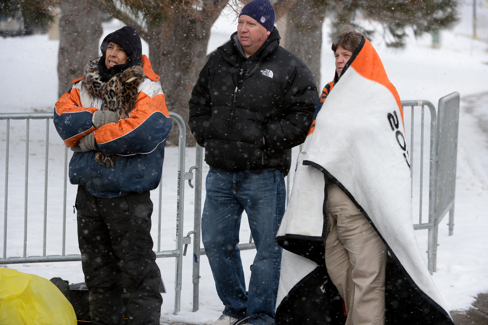 . A small gathering of fans stood out in sub-freezing weather hoping to get autographs from some of the players as they leave Dove Valley for the season in Englewood, Co on February 4, 2014. Their long wait paid for when Broncos quarterback Peyton Manning stopped and signed autographs for them.  (Photo By Helen H. Richardson/ The Denver Post)