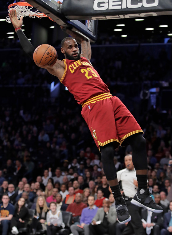 . Cleveland Cavaliers\' LeBron James (23) dunks the ball during the first half of an NBA basketball game against the Brooklyn Nets Friday, Jan. 6, 2017, in New York. (AP Photo/Frank Franklin II)