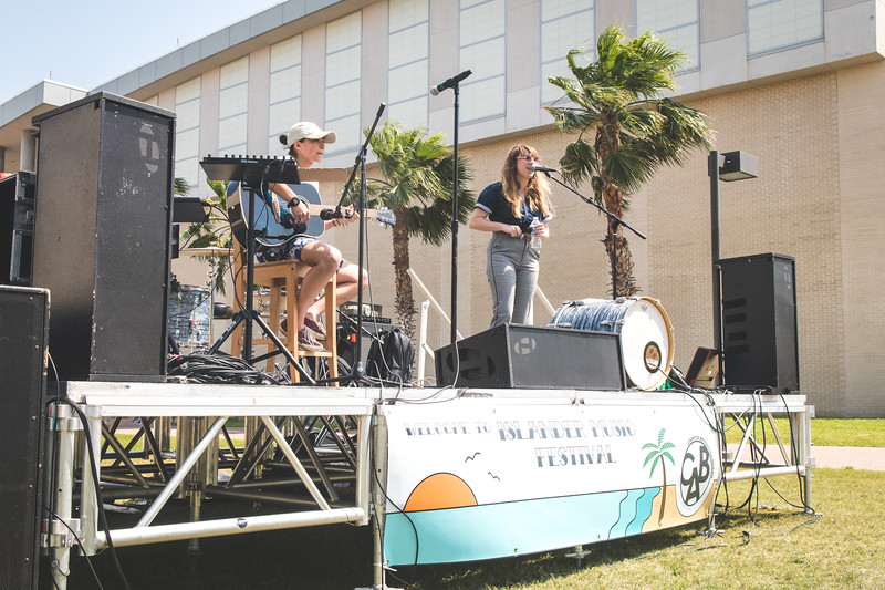 Olivia Whitehurst (left), and Olivia Williamson perform on stage during the Islander Music Festival.