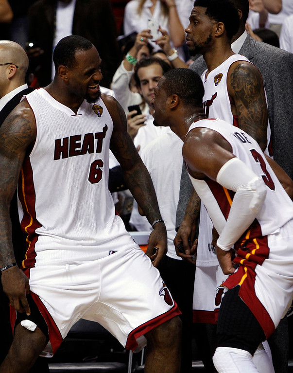 . Miami Heat small forward LeBron James (6) and shooting guard Dwyane Wade react in the final moments during the second half at  Game 5 of the NBA finals basketball series, Thursday, June 21, 2012, in Miami. The Heat won 121-106 to become the 2012 NBA Champions.(AP Photo/Lynne Sladky)