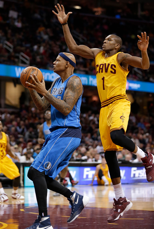 . Dallas Mavericks\' Charlie Villanueva (3) drives past Cleveland Cavaliers\' James Jones (1) in the second half of an NBA preseason basketball game Monday, Oct. 19, 2015, in Cleveland. (AP Photo/Tony Dejak)