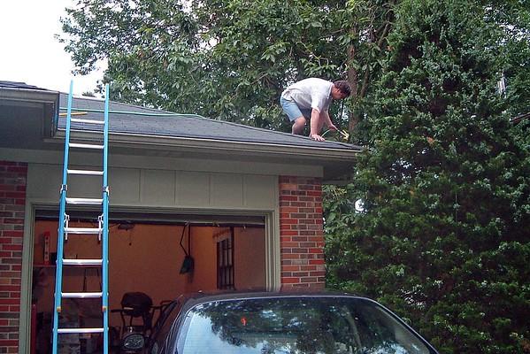June 24, 2003:  Unclogging the gutters .  .  .