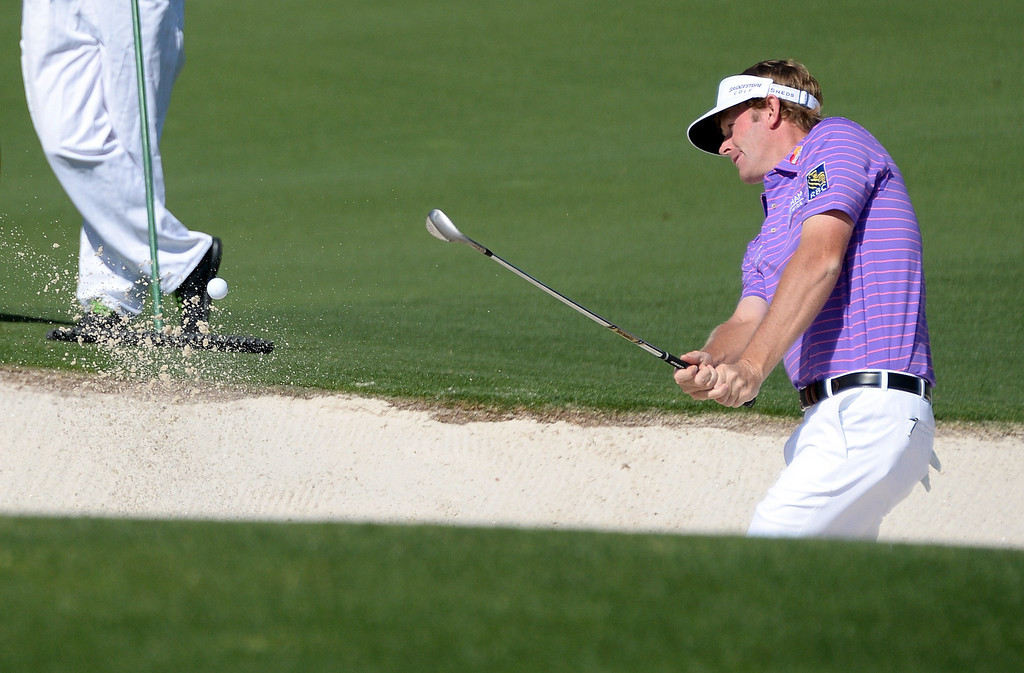 . Brandt Snedeker of the US plays a shot out of a bunker on second green during the first round of the 78th Masters Golf Tournament at Augusta National Golf Club on April 10, 2014 in Augusta, Georgia. The 78th Masters got underway early April 10, with living legends Arnold Palmer, Jack Nicklaus and Gary Player hitting the first balls as honorary starters. AFP PHOTO/Jim WATSON/AFP/Getty Images